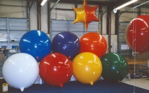 giant helium balloons in assorted sizes and colors